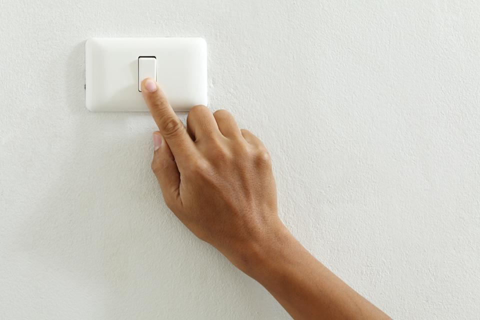 Person touching light switch