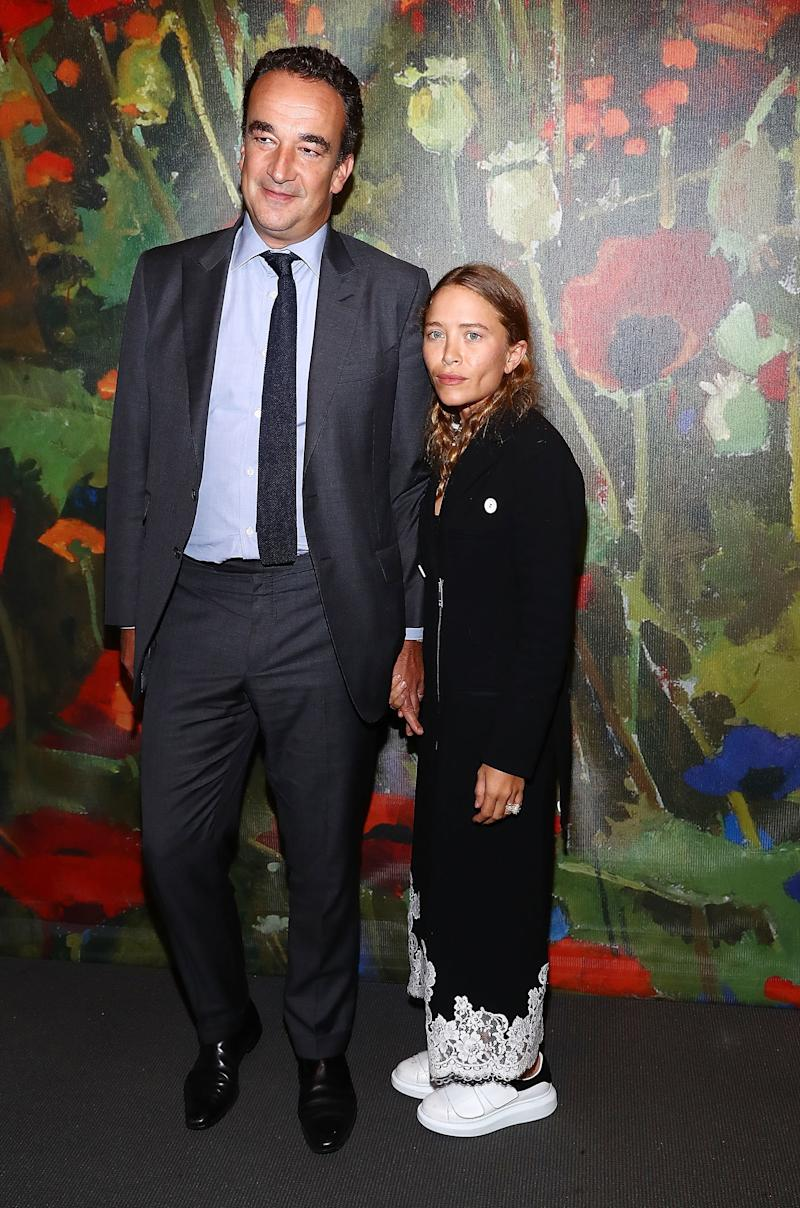 Mary-Kate Olsen and her husband, Olivier Sarkozy, attend the Take Home A Nude Art party and auction at Sotheby's on Oct. 11, 2017 in New York City. (Astrid Stawiarz via Getty Images)