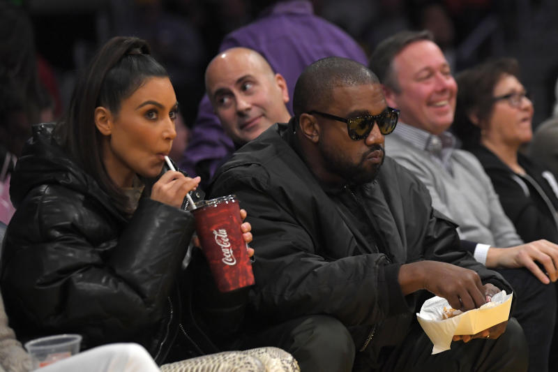 Kim Kardashian, left, and rapper Kanye West watch during the first half of an NBA basketball game between the Los Angeles Lakers and the Cleveland Cavaliers Monday, Jan. 13, 2020, in Los Angeles. The Lakers won 128-99. (AP Photo/Mark J. Terrill)