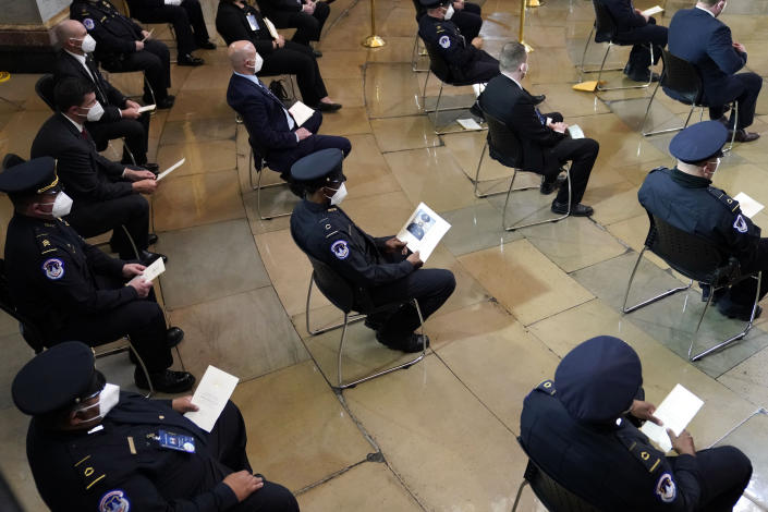 "U.S. Capitol Police officers and other guests, attend a program for U.S. Capitol Police officer William ""Billy"" Evans, as he lies in honor during a ceremony at the Capitol in Washington, Tuesday, April 13, 2021. (Amr Alfiky/The New York Times via AP, Pool)"