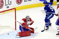 Toronto Maple Leafs' John Tavares (91) scores on Montreal Canadiens goaltender Carey Price (31) during the first period of an NHL hockey game Wednesday, Jan. 13, 2021 in Toronto. (Frank Gunn/The Canadian Press via AP)