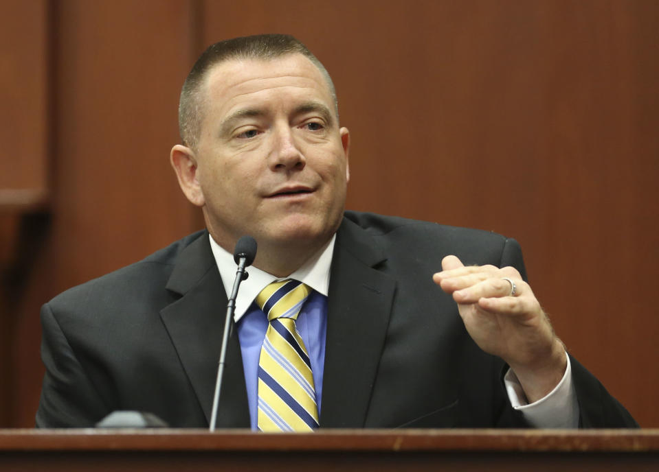 Law enforcement expert Dennis Root testifies during George Zimmerman's trial in Seminole circuit court in Sanford, Fla. Wednesday, July 10, 2013. Zimmerman has been charged with second-degree murder for the 2012 shooting death of Trayvon Martin. (AP Photo/Orlando Sentinel, Gary W. Green, Pool)