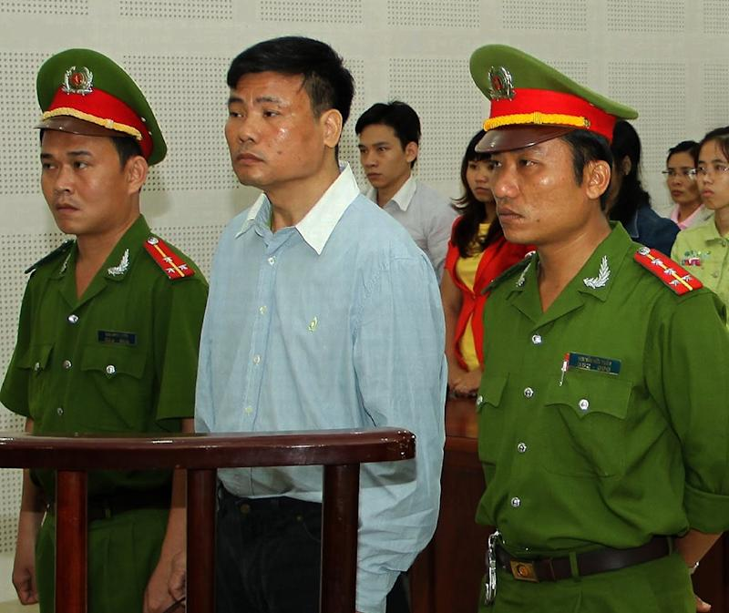 Blogger Truong Duy Nhat on trial in Danang in 2014. He is believed to be back in jail in Hanoi after vanishing in Thailand