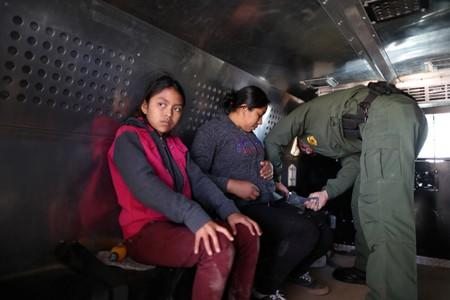 Guatemalan migrants Ismelda Cipriano, 31, and her daughter Petronila Cipriano, 12, sit in a truck after surrendering to U.S. Border Patrol Agents in El Paso