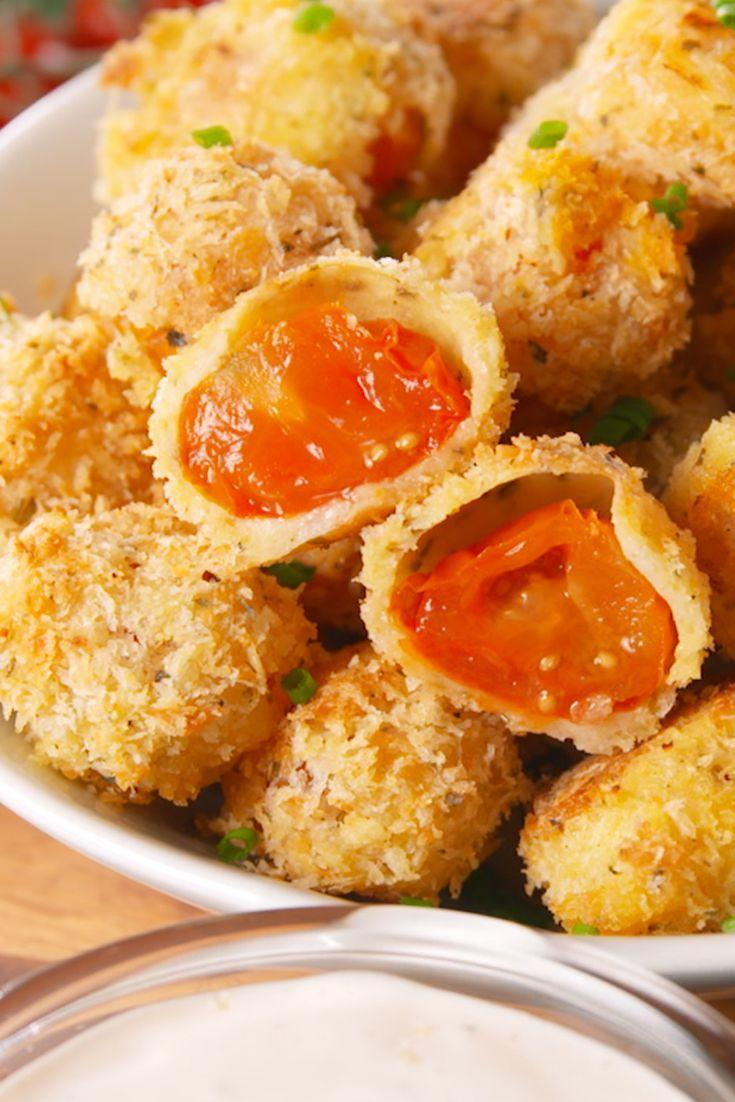"""<p>Pop as many of these juicy babies into your mouth as you want — they're baked!</p><p>Get the recipe from <a href=""""https://www.delish.com/cooking/recipe-ideas/recipes/a54560/oven-fried-cherry-tomatoes-recipe/"""" rel=""""nofollow noopener"""" target=""""_blank"""" data-ylk=""""slk:Delish"""" class=""""link rapid-noclick-resp"""">Delish</a>. </p>"""