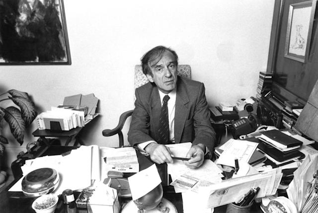 "<p>An Auschwitz survivor turned author, the Nobel Peace Prize was awarded to Elie Wiesel for acting ""messenger to mankind"" about the atrocities of the Holocauset. He died July 2 at age 87. — (Pictured) Writer and political activist Elie Wiesel being interviewed at his home in 1985 in New York City. (Waring Abbott/Getty Images) </p>"