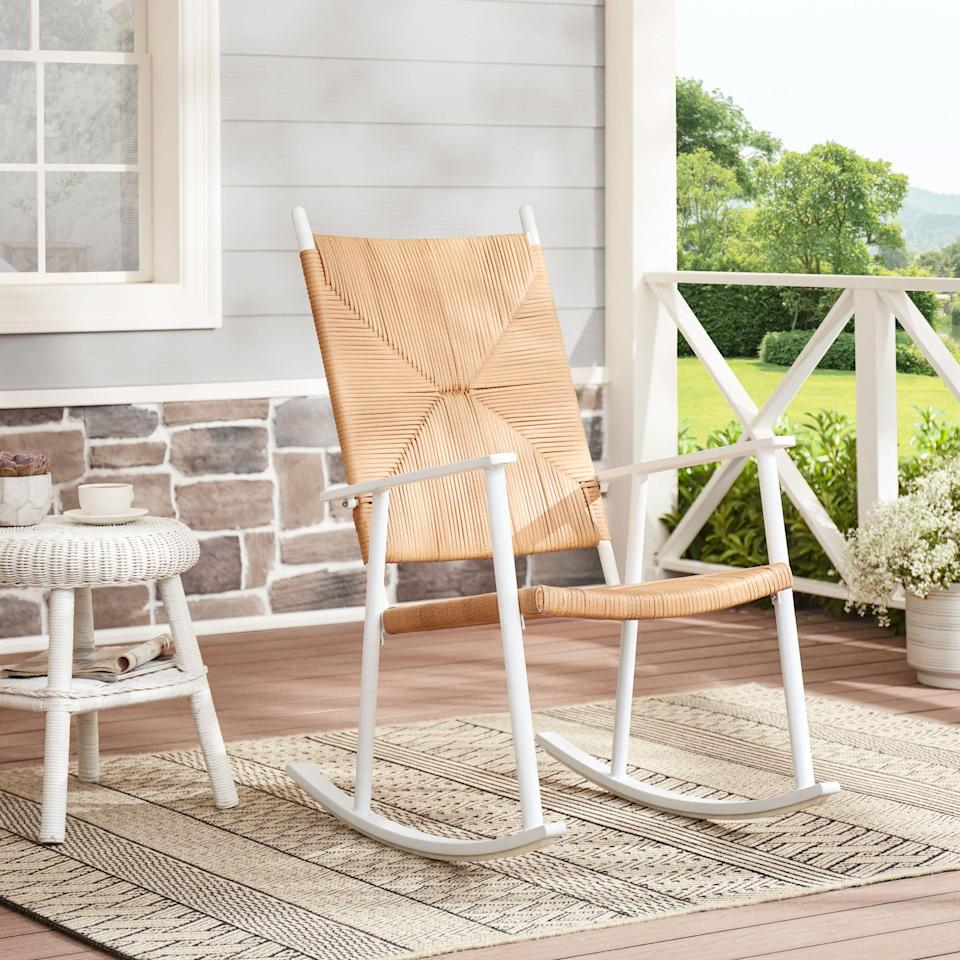 """<p><strong>Better Homes & Gardens</strong></p><p>walmart.com</p><p><strong>$98.00</strong></p><p><a href=""""https://go.redirectingat.com?id=74968X1596630&url=https%3A%2F%2Fwww.walmart.com%2Fip%2F233406745&sref=https%3A%2F%2Fwww.thepioneerwoman.com%2Fhome-lifestyle%2Fdecorating-ideas%2Fg36491091%2Foutdoor-rocking-chairs%2F"""" rel=""""nofollow noopener"""" target=""""_blank"""" data-ylk=""""slk:Shop Now"""" class=""""link rapid-noclick-resp"""">Shop Now</a></p><p>This wicker rocking chair will look awesome on a sunny deck or inside a screened-in porch. It's weather-resistant and made with a durable steel frame.</p>"""