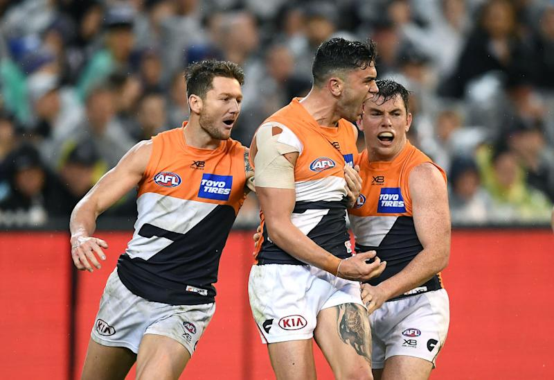Tim Taranto of the Giants is congratulated by team mates after kicking a goal during the AFL Preliminary Final match. (Photo by Quinn Rooney/Getty Images)