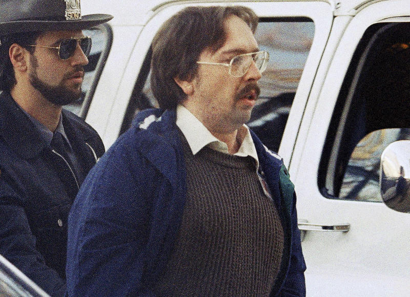 FILE - In this Dec. 17, 1993 file photo, Joel Rifkin, right, is led to the Nassau County Courthouse in Mineola, N.Y., for a suppression hearing.  New Jersey State Police said Wednesday, March 27, 2013, that 25-year-old Heidi Balch likely was the first victim of Rifkin, who is in prison in New York after admitting he killed 17 women in the early 1990s. Balch's severed head was found on a golf course in Hopewell Township, near Trenton, N.J., in March 1989. (AP Photo/Mike Albans, File)