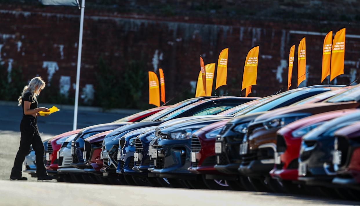 Cars on display at a dealership. (Getty)