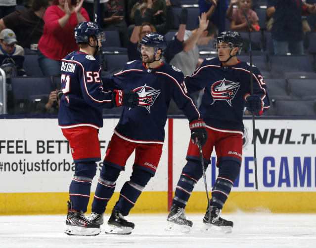Columbus Blue Jackets forward Emil Bemstrom, left, of Sweden, celebrates his goal against the Buffalo Sabers with forwards Oliver Bjorkstrand, center, of Denmark, and Sonny Milano during the first period of an NHL preseason hockey game in Columbus, Ohio, Tuesday, Sept. 17, 2019. The Blue Jackets won 4-1. (AP Photo/Paul Vernon)