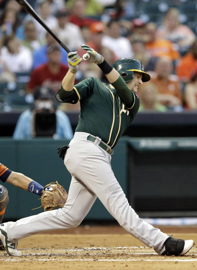 Oakland Athletics' Jed Lowrie follows through on his two-run single against the Houston Astros in the second inning of a baseball game on Friday, April 25, 2014, in Houston. (AP Photo/Pat Sullivan)