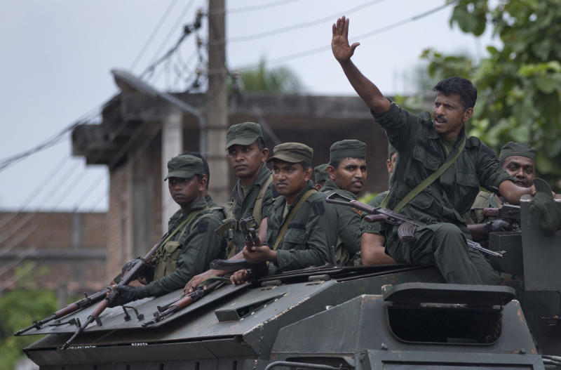 "Soldiers return to their base following an operation searching for explosives and suspects tied to a local group of Islamic State militants in Kalmunai, Sri Lanka, Monday, April 29, 2019. The Catholic Church in Sri Lanka on Monday has urged the government to crack down on Islamic extremists with more vigor ""as if on war footing"" in the aftermath of the Easter bombings. (AP Photo/Gemunu Amarasinghe)"
