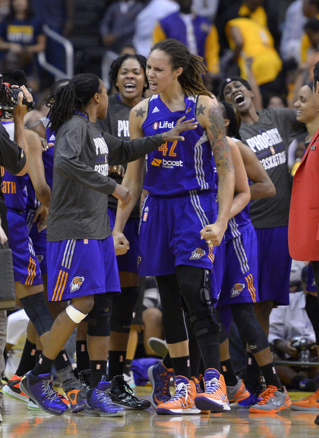 Phoenix Mercury's Brittney Griner, center, celebrates with teammates after they defeated the Los Angeles Sparks in Game 3 of a WNBA basketball Western Conference semifinal series, Monday, Sept. 23, 2013, in Los Angeles. The Mercury won 78-77. (AP Photo/Mark J. Terrill)