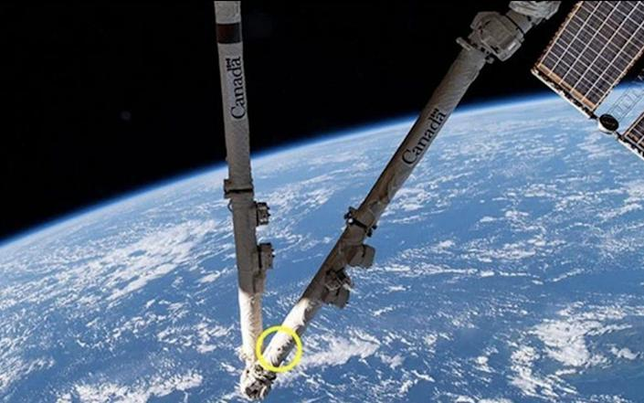The impact has left a 5mm-wide hole in the Canadarm2 - CSA/NASA