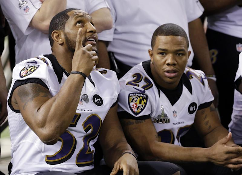 Baltimore Ravens linebacker Ray Lewis (52) and Ray Rice pose for a team picture during media day for the NFL Super Bowl XLVII football game Tuesday, Jan. 29, 2013, in New Orleans. (AP Photo/Pat Semansky)