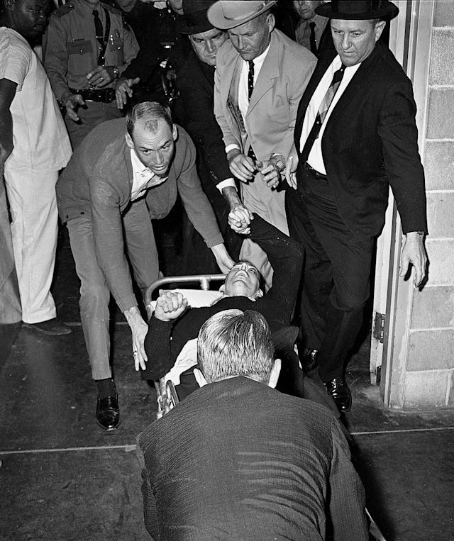 <p>Lee Harvey Oswald, accussed assassin of President John F. Kennedy, is rushed into Parkland Hospital in Dallas, Nov. 24, 1963. Nightclub owner Jack Ruby shot and killed Oswald as he was being transferred through the city jail's underground garage. Parkland Hospital also treated President Kennedy's fatal wounds two days earlier. (Photo: Ted Powers/AP) </p>