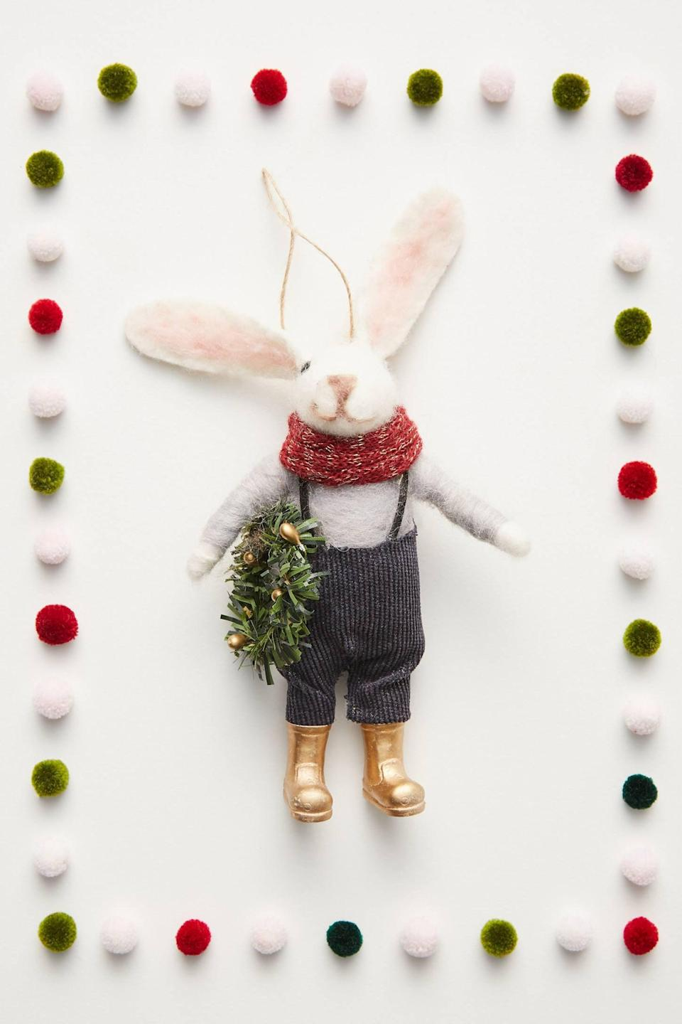 """<p>The <a href=""""https://www.popsugar.com/buy/Rabbit-Farmer-Ornament-490558?p_name=Rabbit%20Farmer%20Ornament&retailer=anthropologie.com&pid=490558&price=20&evar1=casa%3Aus&evar9=46615300&evar98=https%3A%2F%2Fwww.popsugar.com%2Fhome%2Fphoto-gallery%2F46615300%2Fimage%2F46615429%2FRabbit-Farmer-Ornament&list1=shopping%2Canthropologie%2Choliday%2Cchristmas%2Cchristmas%20decorations%2Choliday%20decor%2Chome%20shopping&prop13=mobile&pdata=1"""" rel=""""nofollow noopener"""" class=""""link rapid-noclick-resp"""" target=""""_blank"""" data-ylk=""""slk:Rabbit Farmer Ornament"""">Rabbit Farmer Ornament</a> ($20) is wearing gold boots that are so stylish. </p>"""