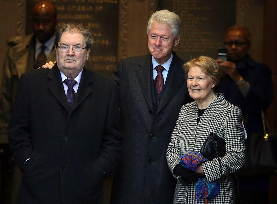 Former US president Bill Clinton (centre) with former SDLP leader John Hume and his wife Pat at the Guildhall in Londonderry (Paul Faith/PA) (PA Archive)