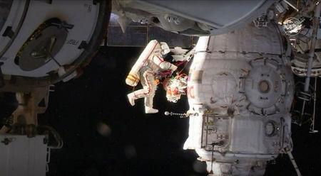 Russian cosmonauts take spacewalk to probe mystery of craft hole