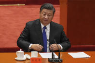 Chinese President Xi Jinping looks as he arrives at an event commemorating the 110th anniversary of Xinhai Revolution at the Great Hall of the People in Beijing, Saturday, Oct. 9, 2021. Xi said on Saturday reunification with Taiwan must happen and will happen peacefully, despite a ratcheting-up of China's threats to attack the island. (AP Photo/Andy Wong)
