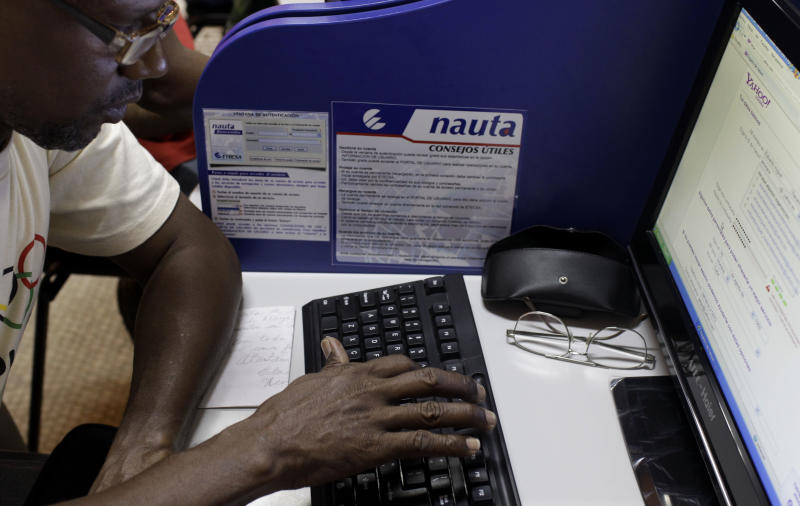 Eduardo Navarrete, 53, creates his first Yahoo account at a branch of the state-run telecommunications company, ETECSA, in Havana, Cuba, Tuesday, June 4, 2013. The Cuban government announced it would provide access to the Internet at more than 100 hotspots beginning Tuesday. To date full international access was limited to hotels and in a few special cases, foreign firms. (AP Photo/Franklin Reyes)