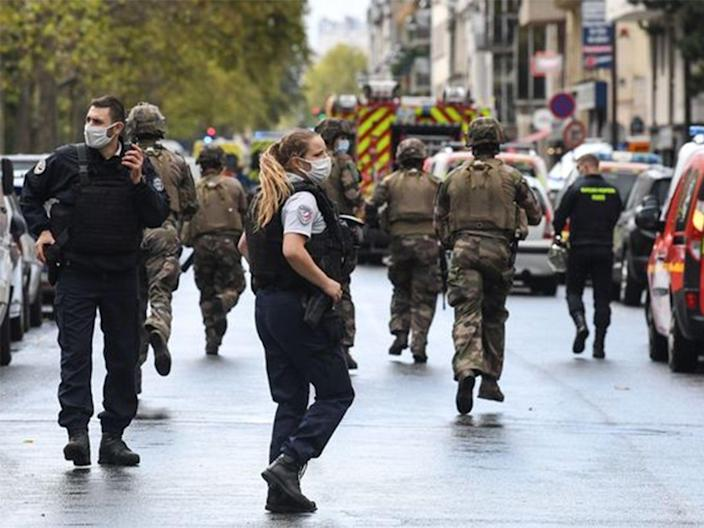 Soldiers and armed police at the scene on Friday (AFP/Getty)