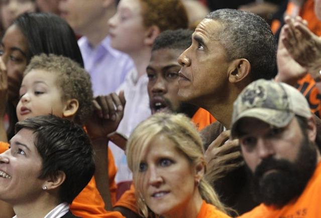 U.S. President Barack Obama (top, R) attends the game between Princeton and Green Bay for the 2015 Women's NCAA Basketball Tournament at the XFINITY Center in College Park, Maryland March 21, 2015. Obama's niece Leslie Robinson plays for Princeton. REUTERS/Yuri Gripas