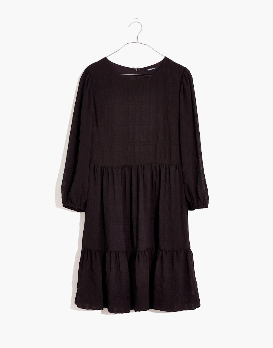 """<p><strong>Madewell</strong></p><p>madewell.com</p><p><a href=""""https://go.redirectingat.com?id=74968X1596630&url=https%3A%2F%2Fwww.madewell.com%2Fpuff-sleeve-ruffle-hem-mini-dress-MC329.html&sref=https%3A%2F%2Fwww.marieclaire.com%2Ffashion%2Fg36053744%2Fmadewell-spring-sale-2021%2F"""" rel=""""nofollow noopener"""" target=""""_blank"""" data-ylk=""""slk:SHOP IT"""" class=""""link rapid-noclick-resp"""">SHOP IT</a></p><p><strong><del>$128</del> $70 (45% off)</strong></p><p>Last but absolutely not least: You'll be able to wear this breezy little black dress on repeat for years to come. Fin!</p>"""