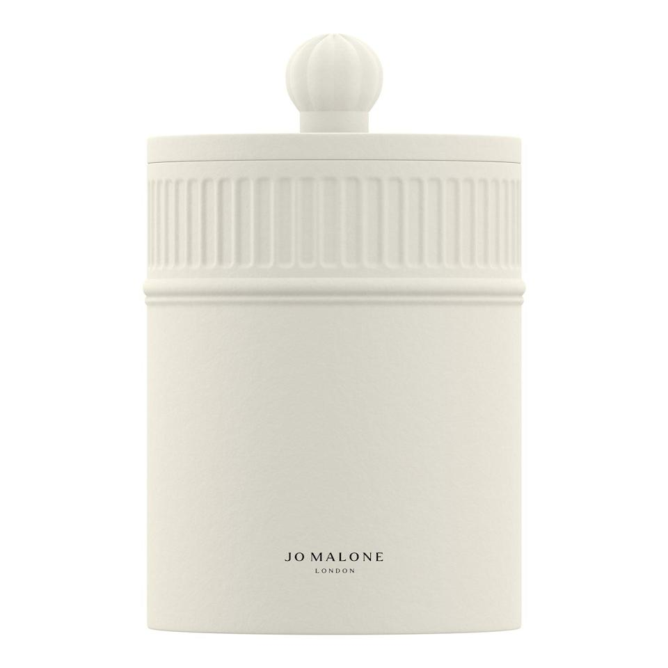 """<p>Jo Malone Fresh Fig & Cassis</p><p>£90</p><p>Jomalone.co.uk</p><p><a class=""""link rapid-noclick-resp"""" href=""""https://go.redirectingat.com?id=127X1599956&url=https%3A%2F%2Fwww.jomalone.co.uk%2Fproduct%2F27211%2F80698%2Fhome-collection%2Ftownhouse-collection%2Fwild-berry-bramble-townhouse-candle%3Fsize%3D300g&sref=https%3A%2F%2Fwww.harpersbazaar.com%2Fuk%2Fbeauty%2Ffragrance%2Fg30698193%2Fbest-scented-candles%2F"""" rel=""""nofollow noopener"""" target=""""_blank"""" data-ylk=""""slk:SHOP NOW"""">SHOP NOW</a></p><p>Jo Malone has just launched what might be its chicest home-fragrance offering to date. The Townhouse Collection comprises clean white ceramic vessels that house five brand-new scents, each one chosen to enhance the atmosphere of any room. </p><p>Our pick is Fresh Fig & Cassis – a fruity ode to the end of summer. Something smokier? <a href=""""https://go.redirectingat.com?id=127X1599956&url=https%3A%2F%2Fwww.jomalone.co.uk%2Fproduct%2F27211%2F80700%2Fhome-collection%2Ftownhouse-collection%2Fglowing-embers-townhouse-candle%3Fsize%3D300g&sref=https%3A%2F%2Fwww.harpersbazaar.com%2Fuk%2Fbeauty%2Ffragrance%2Fg30698193%2Fbest-scented-candles%2F"""" rel=""""nofollow noopener"""" target=""""_blank"""" data-ylk=""""slk:Glowing Embers"""" class=""""link rapid-noclick-resp"""">Glowing Embers</a> will conjure the cosiness of a crackling log fire. </p>"""