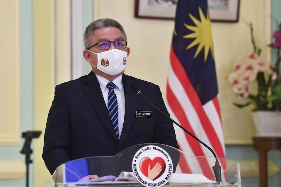 Dr Adham Baba speaks at a press conference after the launch of the National Immunisation Program website and guidebook launch in Putrajaya February 16, 2021. — Bernama pic