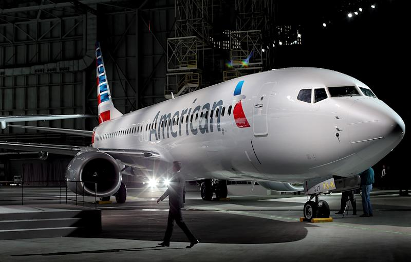 American Airlines unveils a new company logo and exterior paint scheme on a Boeing 737-800 aircraft on January 17, 2013 in Dallas, Texas (AFP Photo/Tom Pennington)