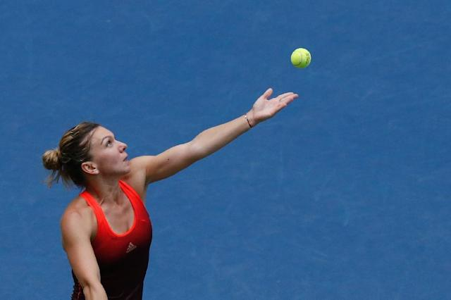Simona Halep (pictured) faces Italian 26th seed Flavia Pennetta in the opener at Arthur Ashe Stadium starting at 11 a.m on September 11, 2015 (AFP Photo/Kena Betancur)