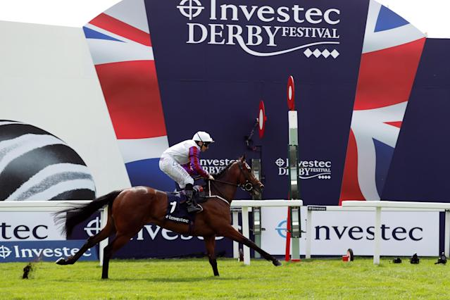 Horse Racing - Derby Festival - Epsom Downs Racecourse, Epsom, Britain - June 1, 2018 Cosmic Law ridden by P J McDonald wins the 2.00 Investec Woodcote EBF Stakes Action Images via Reuters/Andrew Boyers