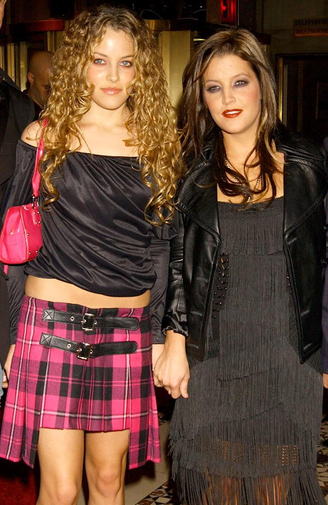 <p>Here are Lisa Marie and her eldest daughter, Riley, hitting a fashion show together in 2003. Her daughter, a model and actress, married stuntman Ben Smith-Petersen in 2012 after she met him while filming <em>Mad Max: Fury Road</em>. (Photo: Bill Davila/FilmMagic) </p>