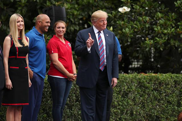 U.S. President Donald Trump wags his finger as he stands with his daughter and advisor Ivanka Trump, former New York Yankees baseball player Mariano Rivera and three time Olympic gold medal volleyball player Misty May-Treaner as young participants run during the White House Sports and Fitness Day event on the South Lawn of the White House in Washington, U.S., May 30, 2018. REUTERS/Jonathan Ernst