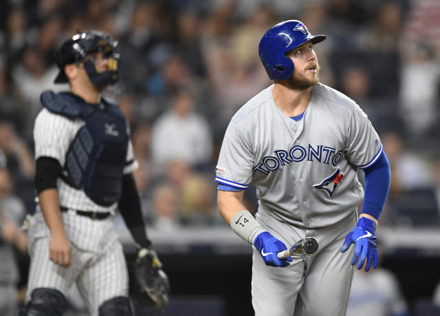 Toronto Blue Jays' Justin Smoak jogs to first while watching his two-run home run during the seventh inning of the team's baseball game against the New York Yankees, Friday, Sept. 20, 2019, in New York. (AP Photo/Sarah Stier)
