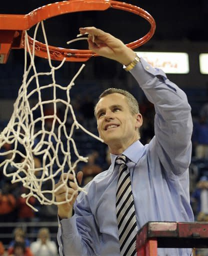 Florida head coach Billy Donovan tugs on the net as he cuts it down following Florida's defeat of Vanderbilt 64-40 in an NCAA college basketball game in Gainesville, Fla., Wednesday, March 6, 2013. (AP Photo/Phil Sandlin)