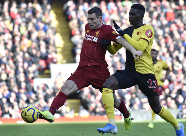 Watford's Ismaila Sarr, right, challenges Liverpool's James Milner during the English Premier League soccer match between Liverpool and Watford at Anfield stadium in Liverpool, England, Saturday, Dec. 14, 2019. (AP Photo/Rui Vieira)