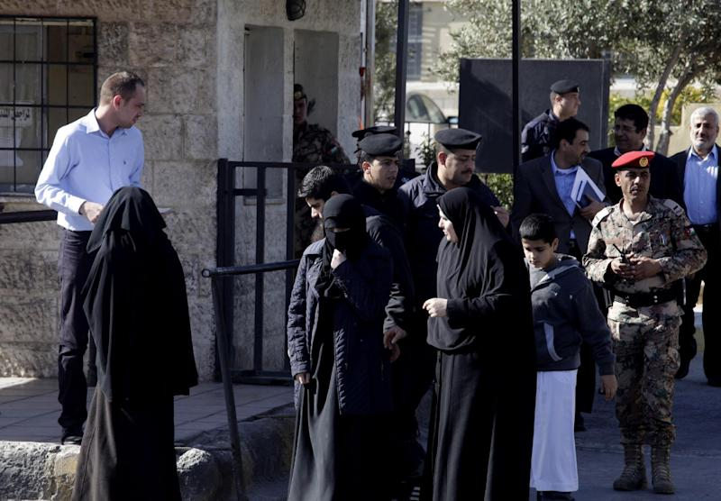 """The relatives of radical Sunni preacher, Abu Qatada, leave the Jordanian military court, in Amman, Jordan, Thursday, Feb. 13, 2014. The 52-year-old Abu Qatada told reporters during a break in his trial on Thursday that he """"supports"""" suicide attacks in Lebanon against Shiite targets. Abu Qatada has been described as a senior al-Qaida figure in Europe who had close ties to the late Osama bin Laden. (AP Photo/Mohammad Hannon)"""