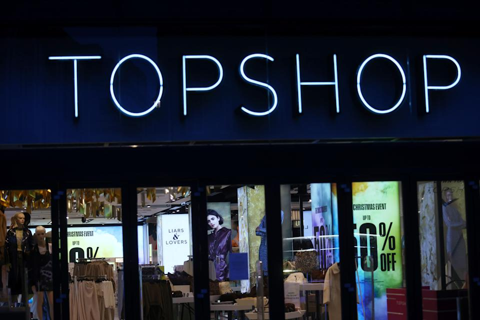 General view of a Topshop store logo, owed by Arcadia group on Oxford street in London, Britain, November 30, 2020. REUTERS/Simon Dawson