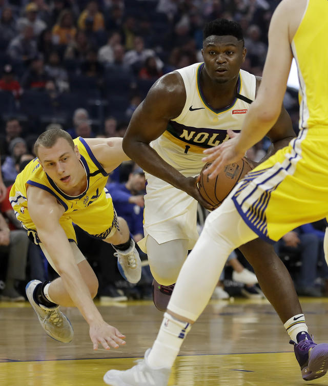 Golden State Warriors' Alen Smailagic, left, falls while covering New Orleans Pelicans' Zion Williamson (1) during the first half of an NBA basketball game Sunday, Feb. 23, 2020, in San Francisco. (AP Photo/Ben Margot)