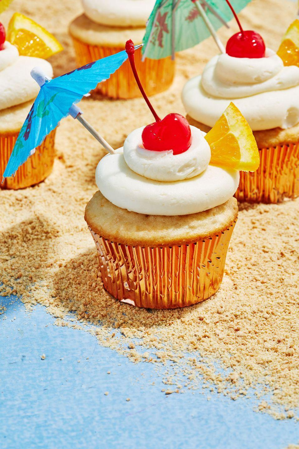 """<p>We couldn't <em>not </em>include these.</p><p>Get the recipe from <a href=""""https://www.delish.com/cooking/recipe-ideas/a19487384/bahama-mama-cupcakes-recipe/"""" rel=""""nofollow noopener"""" target=""""_blank"""" data-ylk=""""slk:Delish"""" class=""""link rapid-noclick-resp"""">Delish</a>.</p>"""