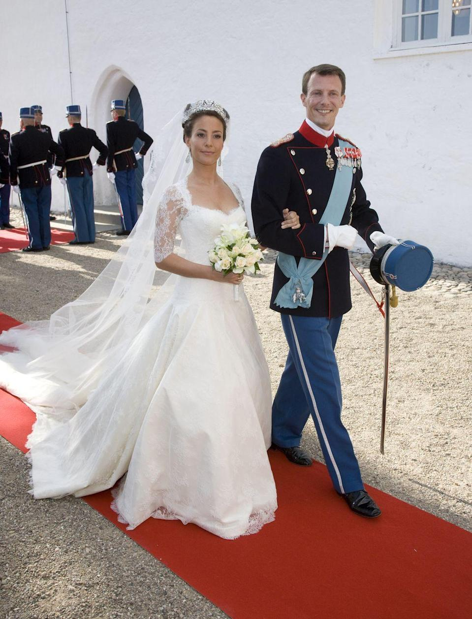 <p>Princess Marie of Denmark married Prince Joachim on May 24, 2008 at Møgeltønder Church. Her dress was designed by David Arasa and Claudio Morelli. Covered in lace from head to toe, the low-waist, ivory silk faille gown also featured a floral pattern in raised satin stitch. </p>
