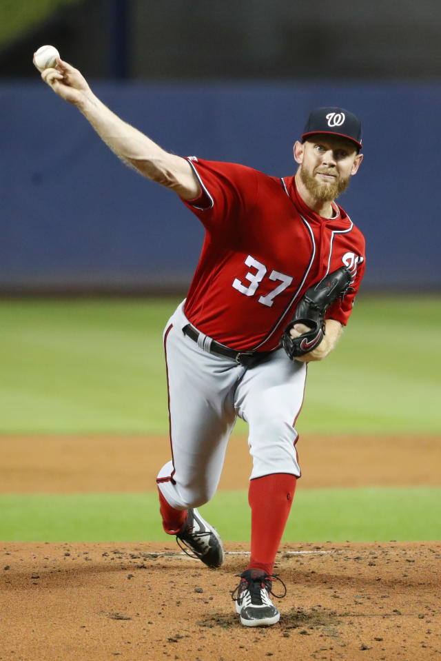 Washington Nationals' Stephen Strasburg pitches during the first inning of a baseball game against the Miami Marlins, Saturday, Sept. 21, 2019, in Miami. (AP Photo/Wilfredo Lee)