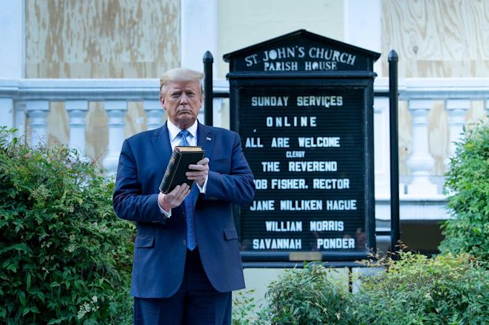 """<span class=""""caption"""">Donald Trump poses with Bible at a moment of national crisis.</span> <span class=""""attribution""""><a class=""""link rapid-noclick-resp"""" href=""""https://www.gettyimages.com/detail/news-photo/president-donald-trump-holds-a-bible-while-visiting-st-news-photo/1216828185?adppopup=true"""" rel=""""nofollow noopener"""" target=""""_blank"""" data-ylk=""""slk:Brendan Smialowski/AFP via Getty Images"""">Brendan Smialowski/AFP via Getty Images</a></span>"""