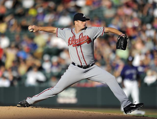 Atlanta Braves starting pitcher Gavin Floyd throws in the first inning of a baseball game against the Colorado Rockies on Monday, June 9, 2014, in Denver. (AP Photo/Chris Schneider)
