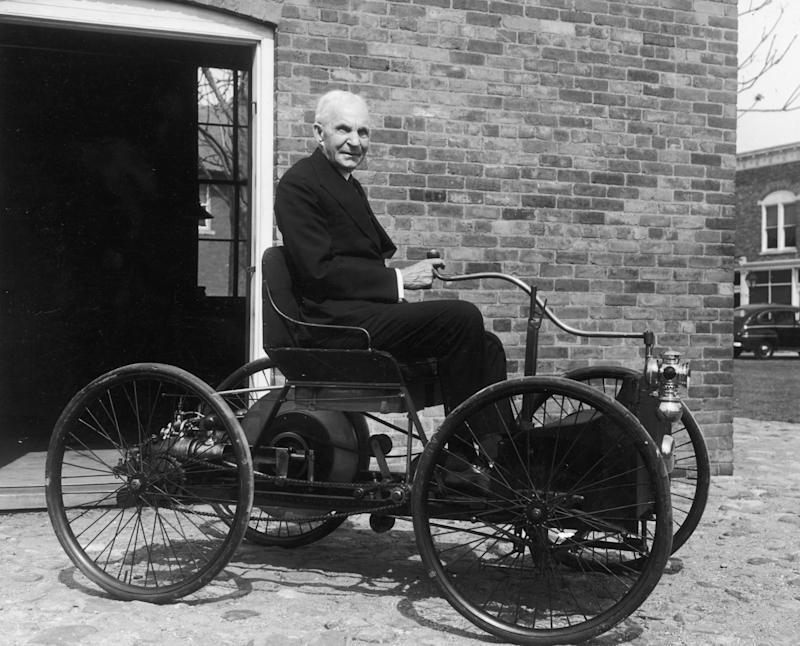 Portrait of American inventor and industrialist Henry Ford (1863 - 1947) sitting in the first automobile he built, a 'quadricycle', in front of his former workshop, 58 Bagley Avenue, Greenfield Village, Michigan, June 1946. | Hulton Archive—Getty Images.