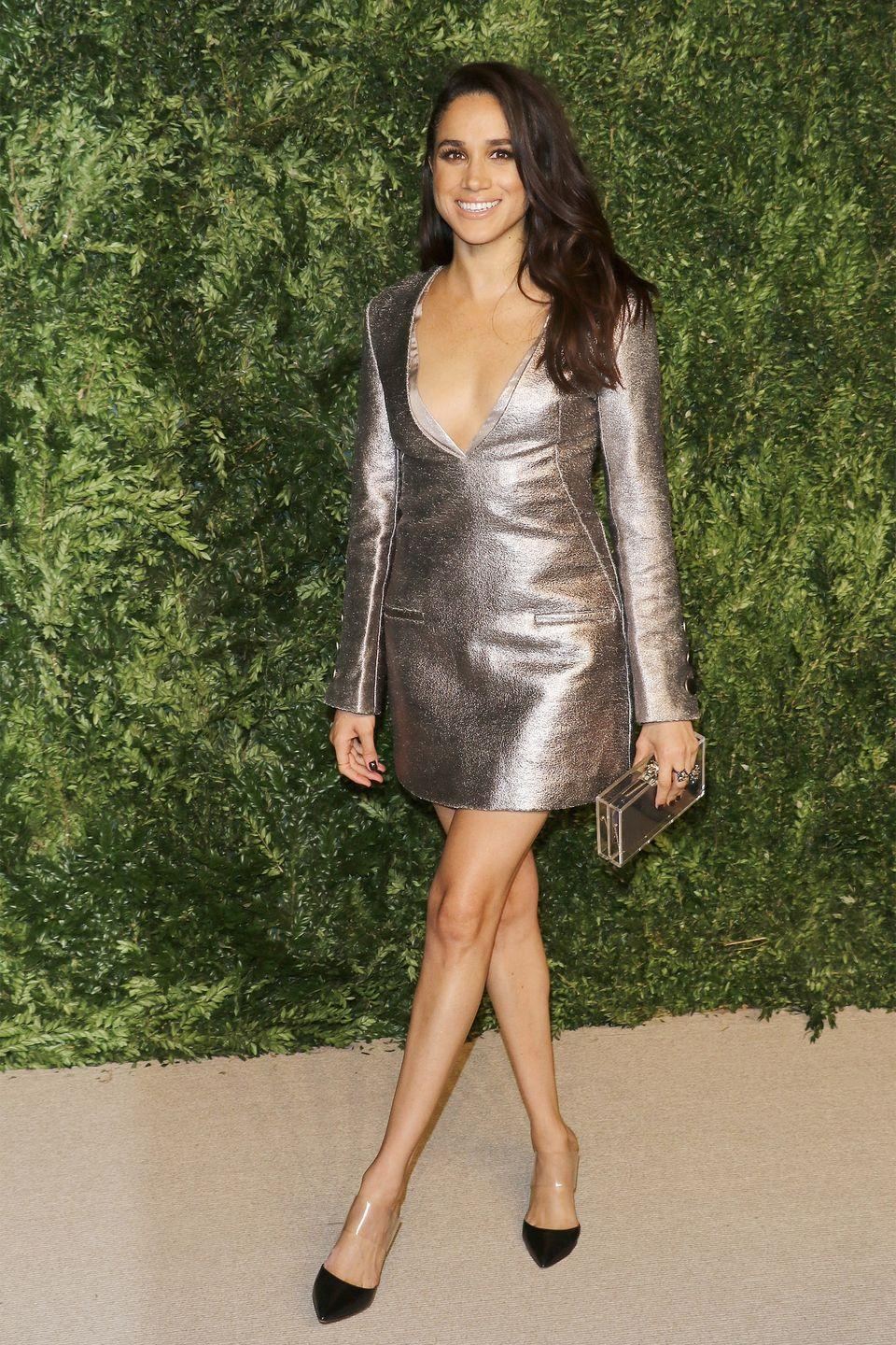<p>Meghan wears a metallic minidress to the 12th-annual CFDA/Vogue Fashion Fund Awards at Spring Studios in New York City. </p>