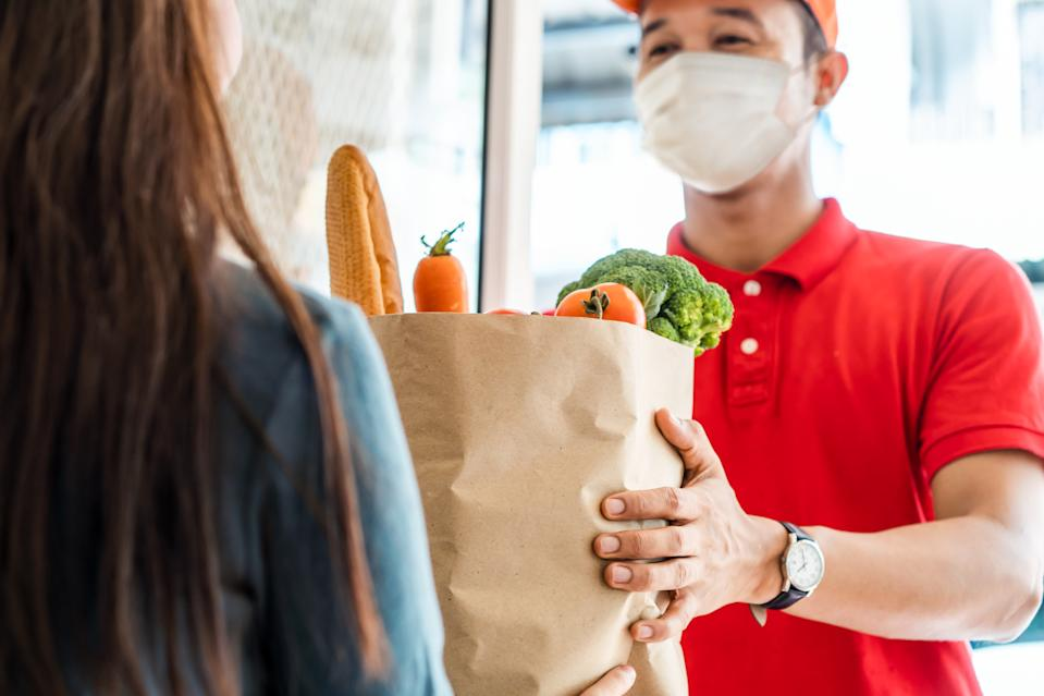 Many people reported they'll continue spending extra on at least one thing, primarily grocery delivery, first-class travel, and spending on high-quality vitamins. (Photo: Getty)
